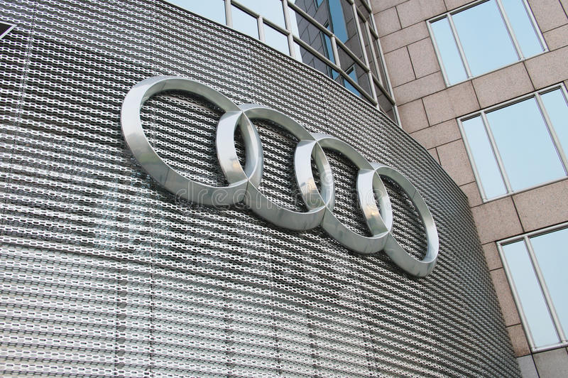 Audi. Beijing, China. Audi sign on the side of the dealerships outside wall. Audi is a German car brand.nPhoto taken on: 2014-04-25 royalty free stock photos