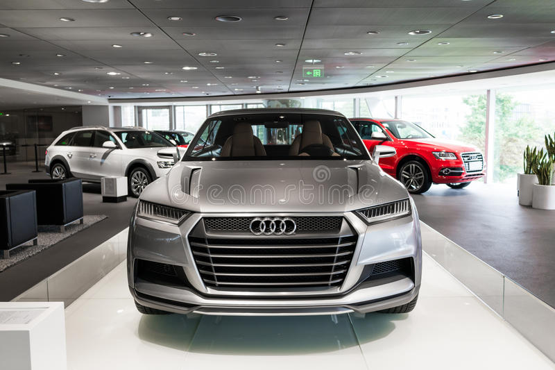 Audi car for sale. Audi Crosslane Coupe concept Q2 in showroom for sale,a plug-in hybrid powertrain that combines a turbocharged, three-cylinder 1.5-liter engine royalty free stock photos