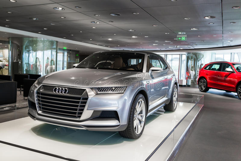 Audi car for sale. Audi Crosslane Coupe concept Q2 in showroom for sale,a plug-in hybrid powertrain that combines a turbocharged, three-cylinder 1.5-liter engine stock photography