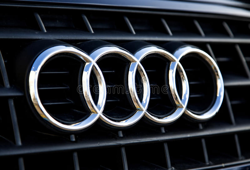 Audi logo. TAORMINA, ITALY - APRIL 28, 2014: Detail of the Audi car in Taormina. Audi is German automobile manufacturer founded at 1932 and now have 9 production stock photo