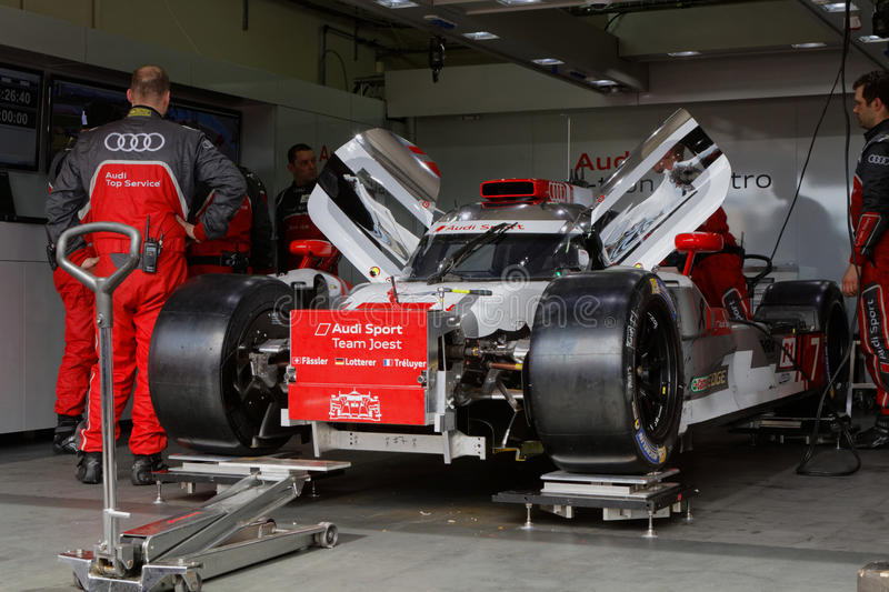 Audi mechanics in the pits. LE CASTELET, FRANCE, March 28, 2015 : Audi mechanics during the training sessions for World Endurance Car Championship, before the royalty free stock images