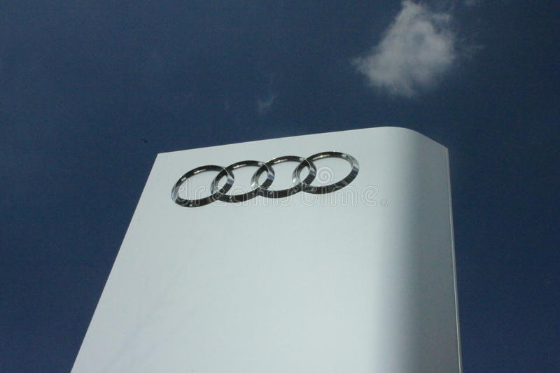 Audi Pylon. A advertising pylon of Audi in front of a car dealership in Frankfurt. The Audi AG was founded in 1909 and is now part of the Volkswagen AG royalty free stock images