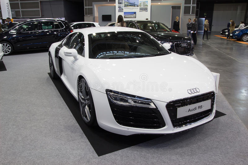 Audi R8. VALENCIA, SPAIN - DECEMBER 4, 2014: A white 2015 Audi R8 sports car at the Valencia Automovil 2014 Car Show. The Audi R8 was introduced by the German royalty free stock image