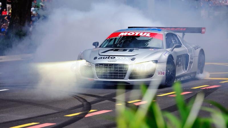 Audi R8 LMS que executa conluios fotografia de stock
