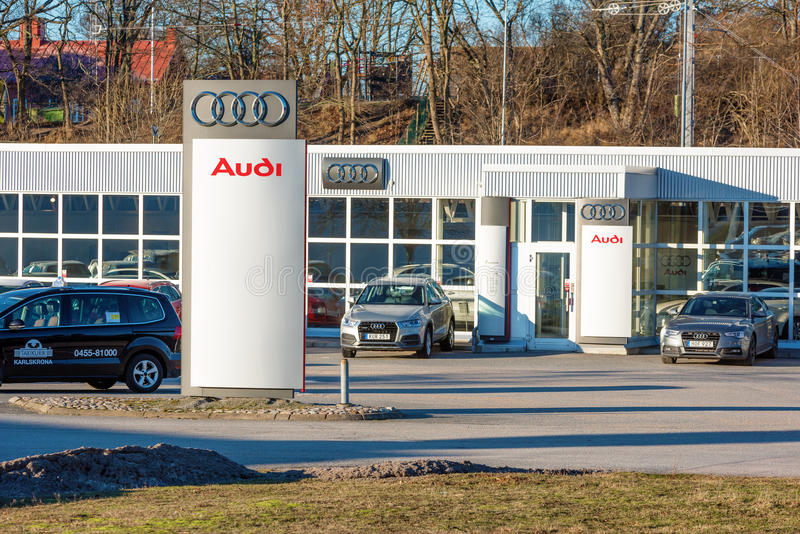 Audi retailer. Karlskrona, Sweden - January 13, 2016: Jeppssons Audi dealer facade with cars in front. One is a silver Audi U8 2015 and another is a gray Audi B8 stock images