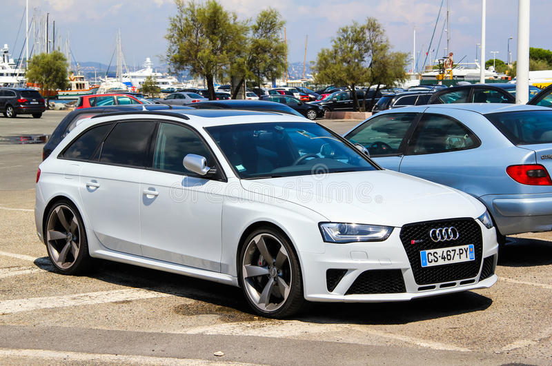Audi RS4. SAINT-TROPEZ, FRANCE - AUGUST 3, 2014: White estate car Audi RS4 at the city street royalty free stock photos