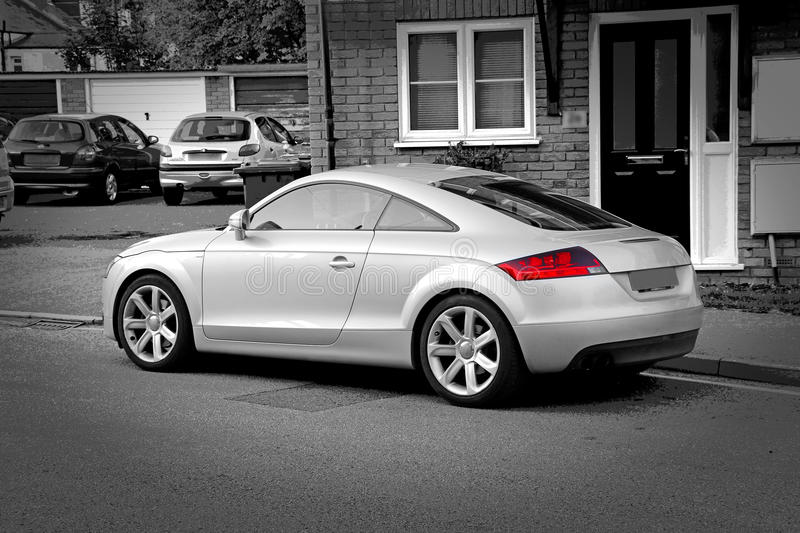 Audi tt amg sports car. Photo of a silver high performance audi tt amg sports car with alloy wheels stock photography