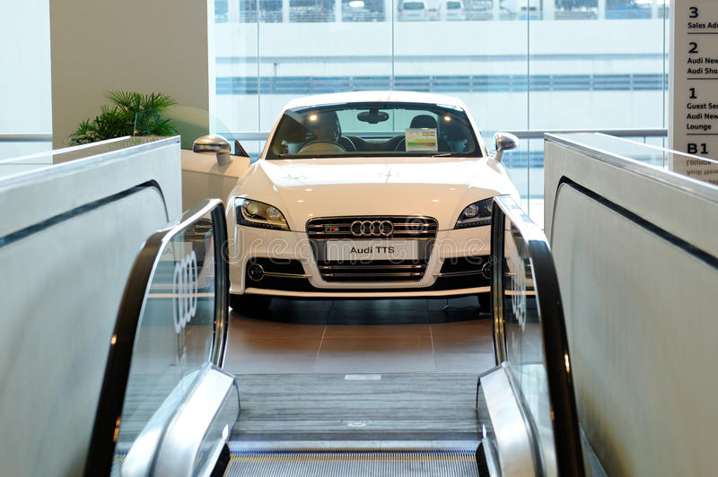 Audi TTS roadster on display at Audi Centre Singapore. White Audi TTS roadster on display during opening of the new Audi Centre Singapore December 15, 2012 in stock photos