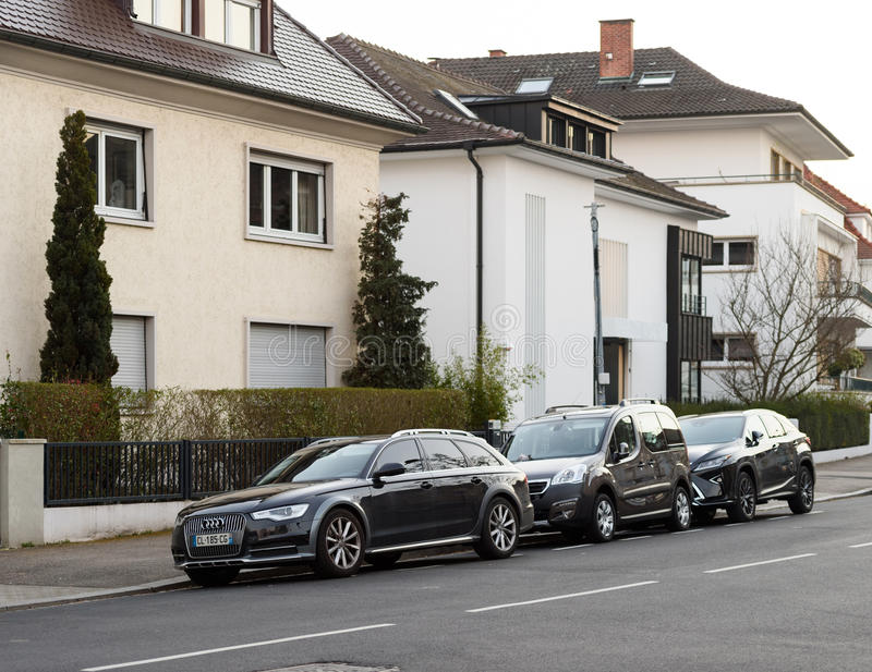 AUDI wagon, Peugeot Car and Lexus Luxury SUV parked royalty free stock image