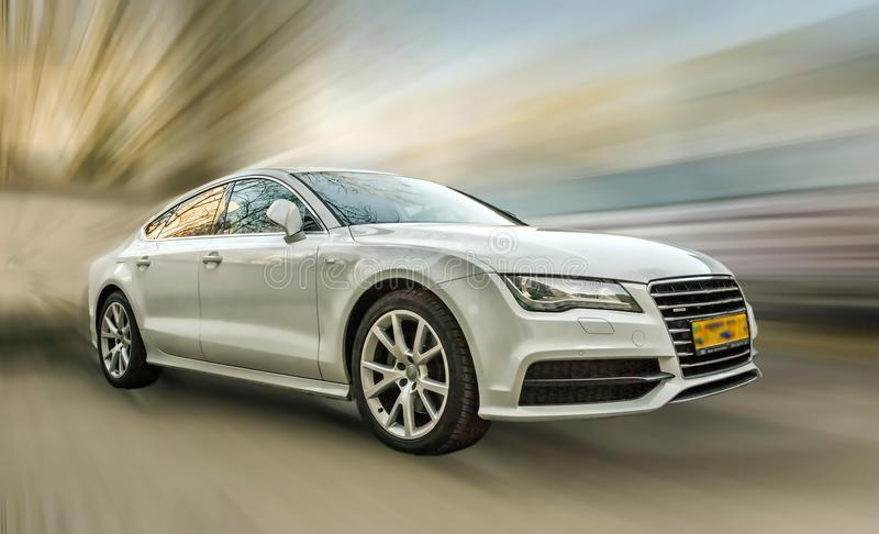 Audi A7 white car. Audi A7 white car on a blurred background in motion royalty free stock photos