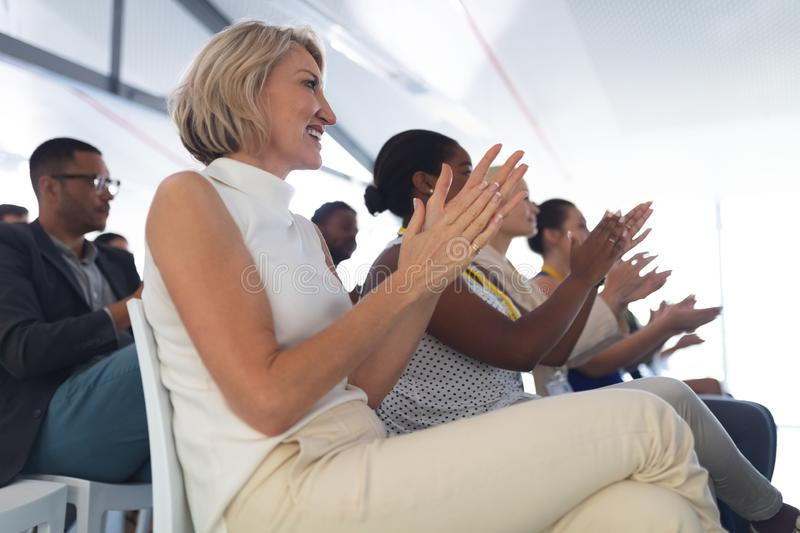 Audience applauding in a business seminar royalty free stock image