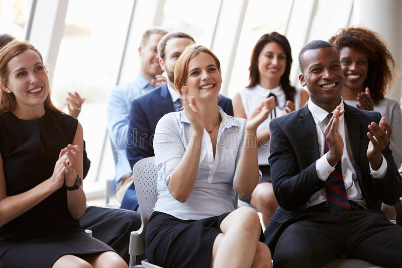 Audience Applauding Speaker At Business Conference stock image