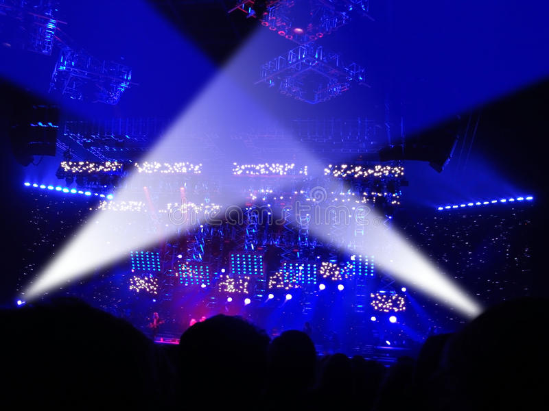 Audience at Concert. Concert lights on stage with audience watching royalty free stock photography