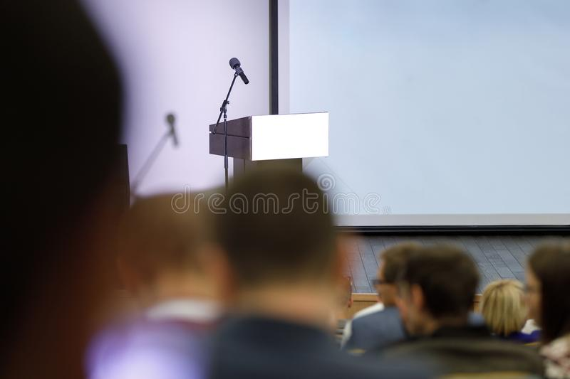Audience at the conference hall. Business conference stock image