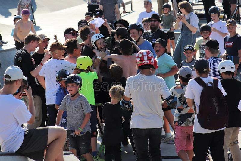 Audience congratulating a participant of FinScooter Summer Jam sport event in a skate park. FinScooter Summer Jam sport event was held in Leppaevaara scate park royalty free stock photo