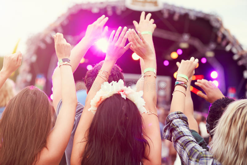 Audience with hands in the air at a music festival royalty free stock photography
