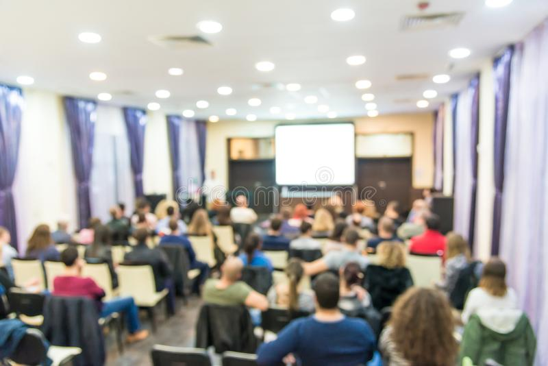 Audience in the lecture hall. At business conference royalty free stock photo
