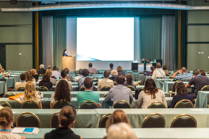 Audience in lecture hall participating at business conference. royalty free stock photos