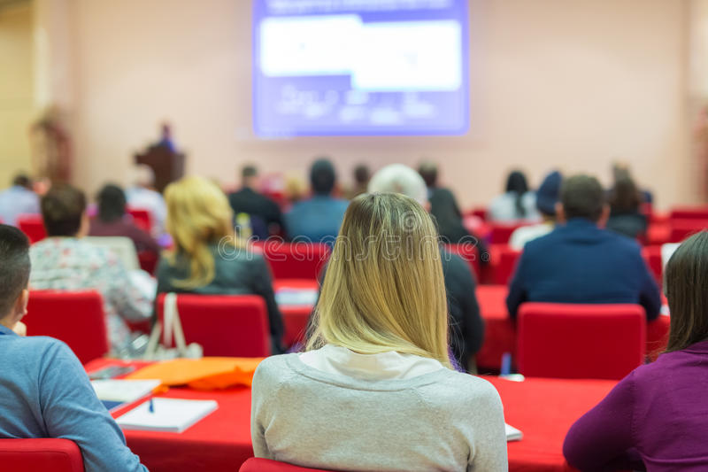Audience in lecture hall on scientific conference. Speaker Giving a Talk at Business Meeting. Audience in the conference hall. Business and Entrepreneurship stock images