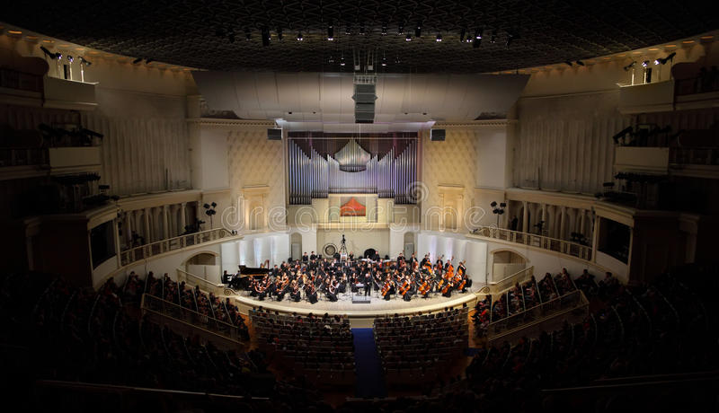 Audience listens to concert of Symphony Orchestra stock photos