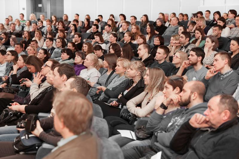 Audience sitting at a press conference in the modern conference hall stock photo