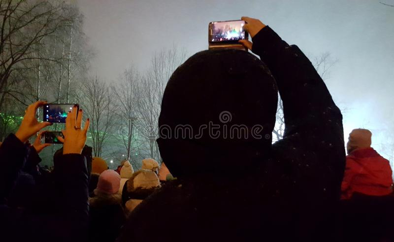 Audience taking pictures with mobile phones. Photographed in laser show - Espoo, Finland. Night, scene, concert, event, gig, performance, light, festival stock images