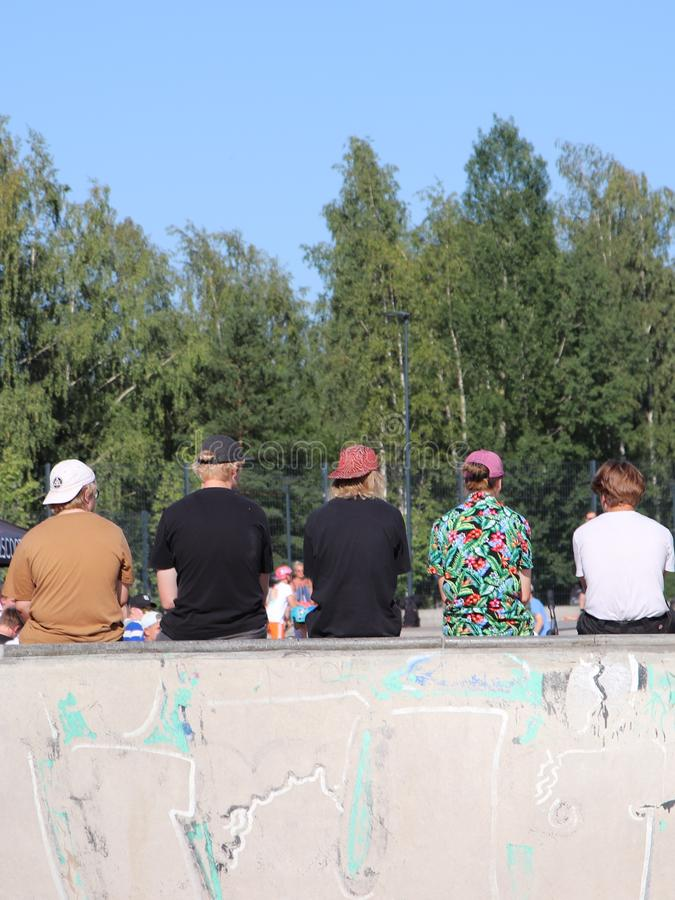 Audience watching FinScooter Summer Jam sport event in a skate park. FinScooter Summer Jam sport event was held in Leppaevaara scate park in Espoo, Finland, from stock images