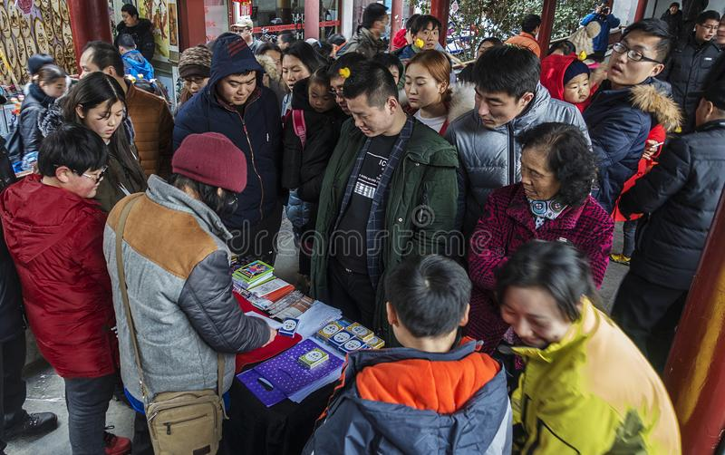 Audience watching street magic show. In February 2017, it was a Chinese New Year. A group of people at the Confucius Temple in Nanjing, China, was watching a royalty free stock images