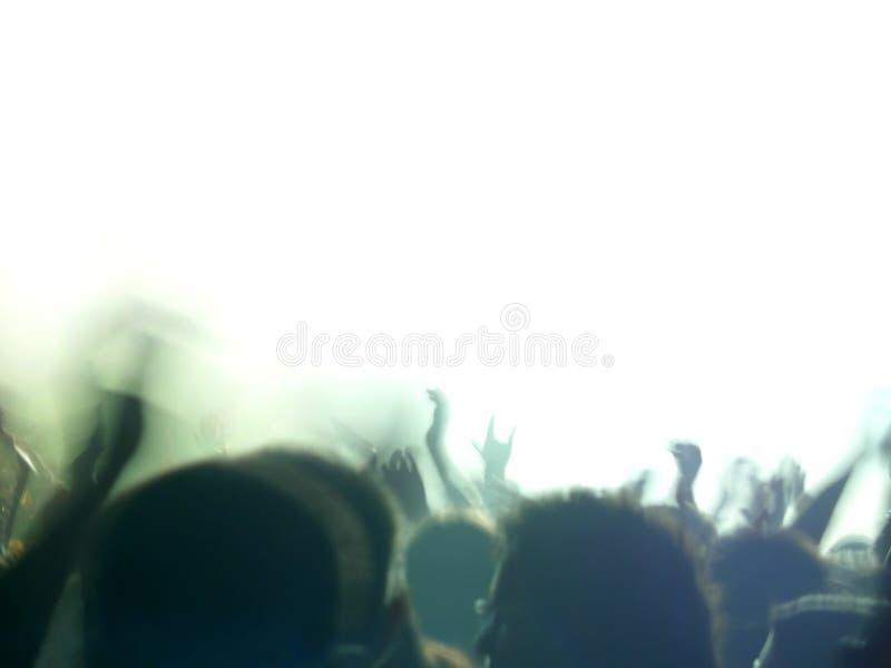 Audiencia del concierto de rock, verde foto de archivo