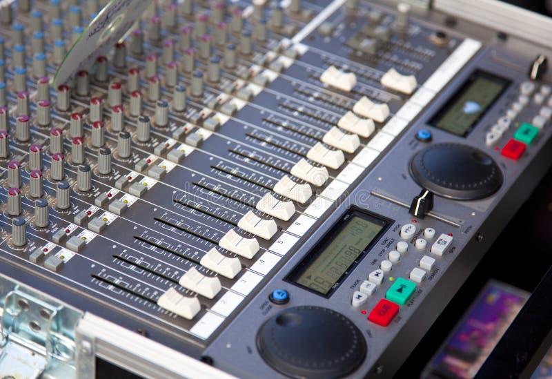 Audio. A audio mixer in detail on a open air festival stock photos