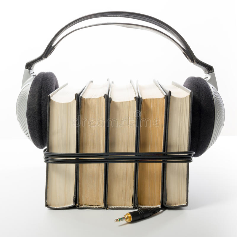 Audio book Stack of hardback books and electronic reader. Electronic library concept. Back to school. Copy space.  royalty free stock images