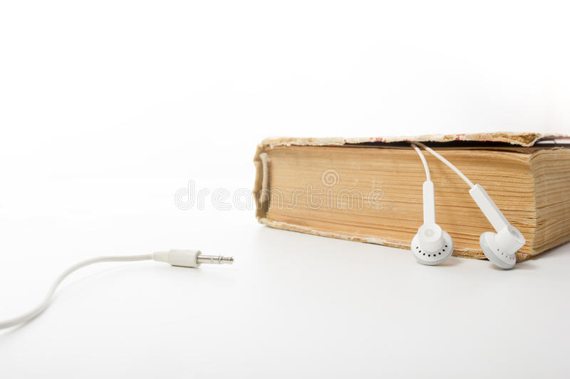 Audio book Stack of hardback books and electronic reader. Electronic library concept. Back to school. Copy space stock photo