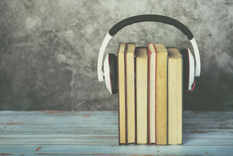 Audio books concept,books and headphones stock images