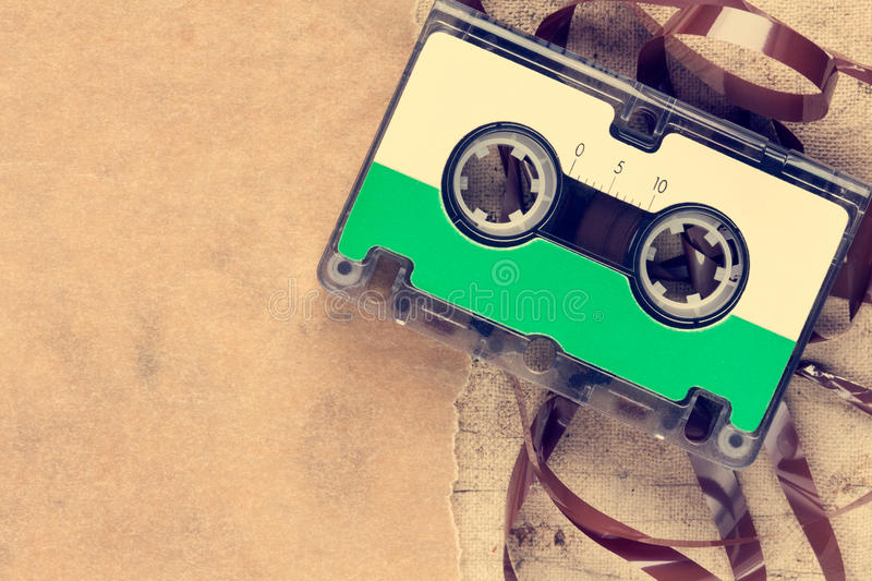 Audio cassette and paper piece royalty free stock photo