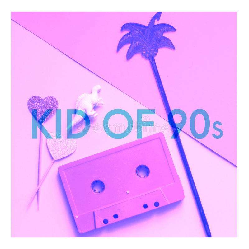 Audio cassette tape, dinosaur figure, palm and text Kid of 90s. Millennials concept collage in pink colors stock photography