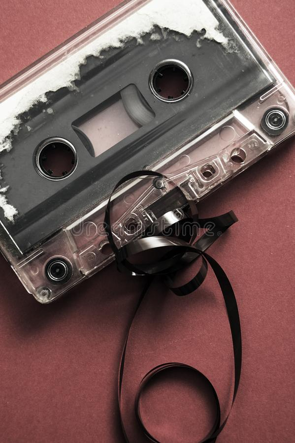Audio cassette tape on red backgound. From above stock photo
