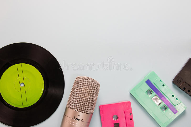 Audio cassettes, microphone and tape recorder. With copy space royalty free stock photos