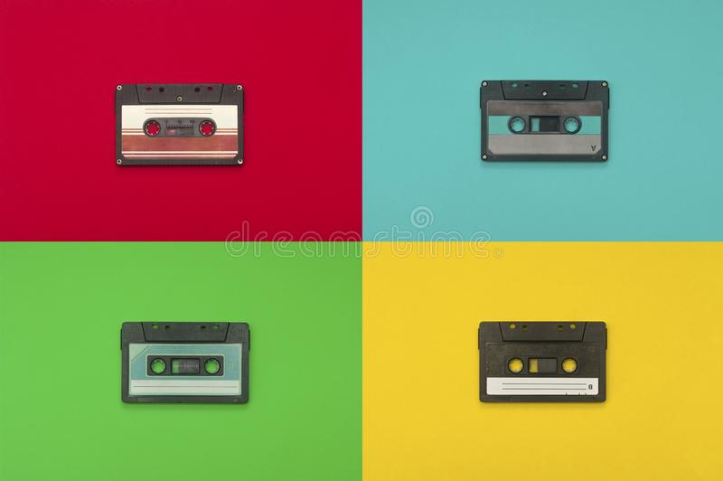 Audio cassettes tape  on multiple colors background royalty free stock photos