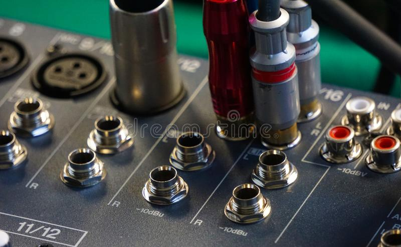 Audio console plugs and rca connectors stock image