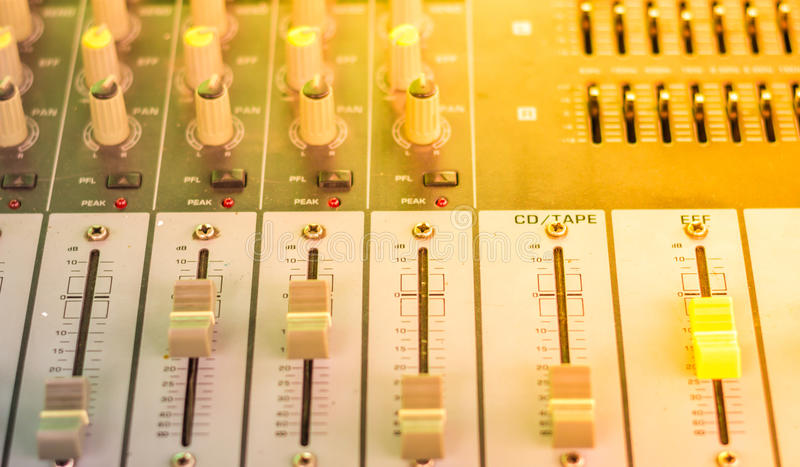 Audio control. Digital sound engineer and soft light royalty free stock photography