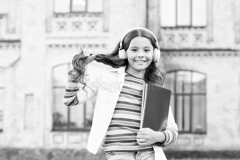 Audio course. Modern technologies. Elearning and modern methods. Listening school book. Digital technologies for. Learning. Schoolgirl hold workbooks and stock photography