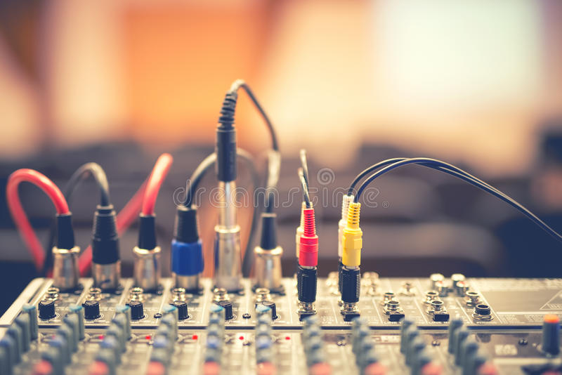 Audio jack and wires connected to audio mixer, music dj equipment stock photos
