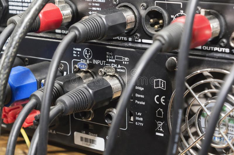 Audio jack and wires connected to audio mixer, music dj equipment at concert, festival, bar. stock photography