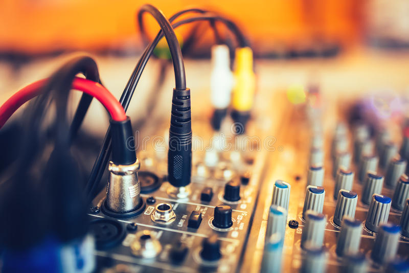 Audio jack and wires connected to audio mixer, music dj equipment at concert, festival, bar royalty free stock image