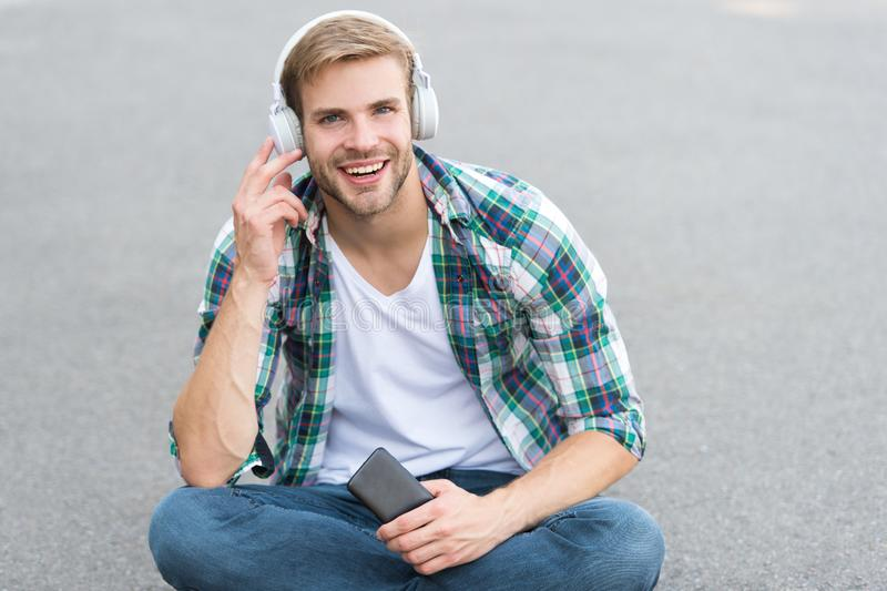 Audio library. Another way of learning. Man handsome college student headphones. Online learning. Audio book concept. Educational technology. E learning. Study stock photo