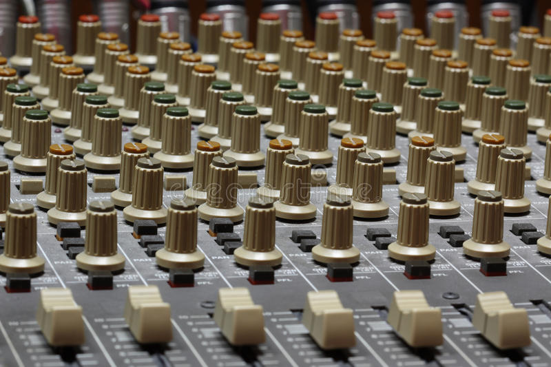 Audio mixer. An audio mixer is an electronic device that channels incoming audio signals while maintaining control over such effects as volume level, tonality stock photography