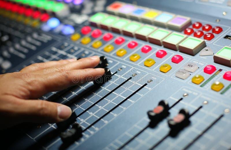 Audio mixer. Mixing board fader and knobs royalty free stock image