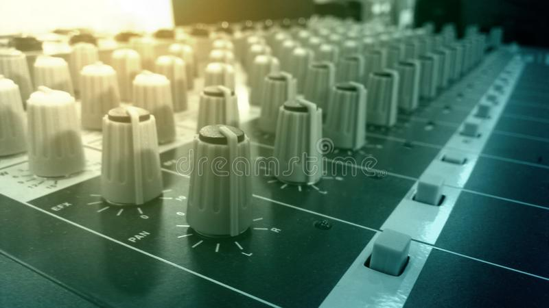 Audio mixer and amplifier knobs in studio sound recording room stock photos