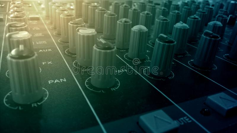 Audio mixer and amplifier knobs in studio sound recording room stock photo