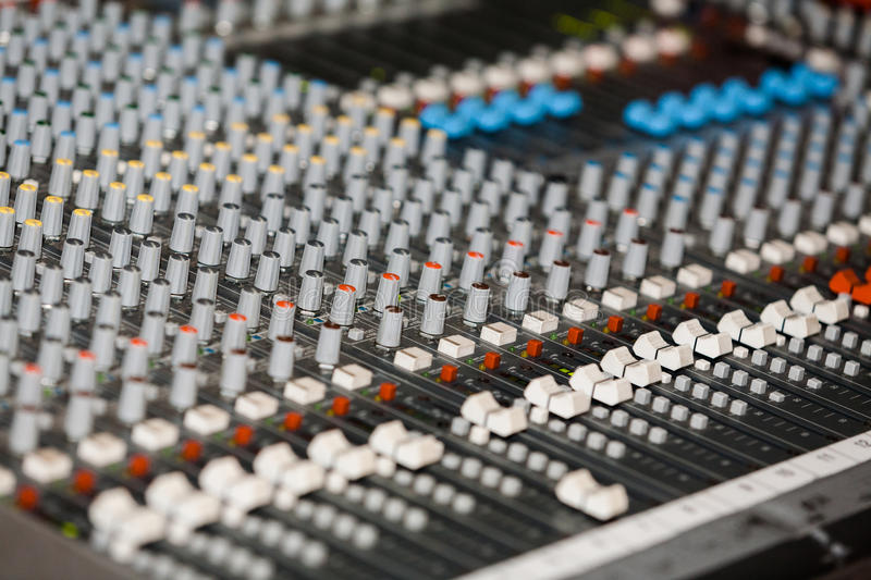 Audio mixer. Detail of a proffesional audio mixer royalty free stock image